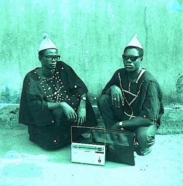 Two friends listen to the radio in the Ivory Coast, 1960s, image courtesy of the BBC Archives