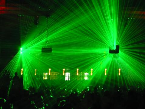 Lasers in a dance club, image by flickr user gabriel.jorby