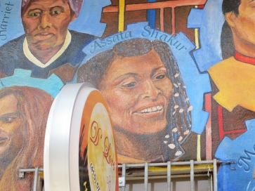 Image of Assata Shakur on Community Mural of Revolutionary Heroes, Image by Flickr User Gary Stevens