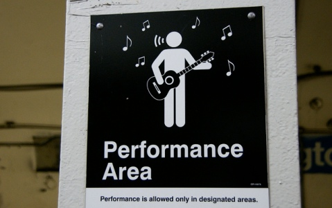 Signs designating public performance areas, downtown Chicago, Image by Flickr User romanaklee