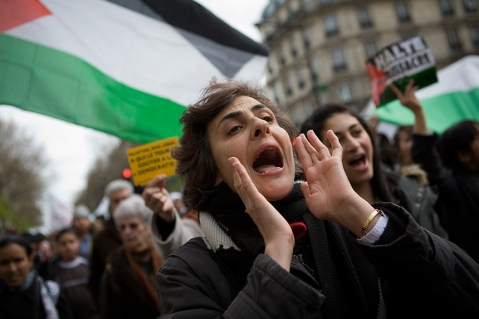 Woman at pro-Palestinian rally in France, Image by Flickr user lookingforpetry