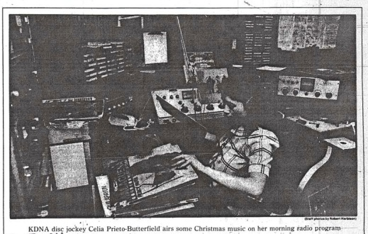 KDNA disc jockey Celia Prieto-Butterfield airs some Christmas music on her morning radio program. Yakima Herald Republic, 17 December 1984.