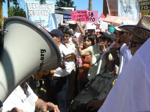 Rallying the Crowd with a Bullhorn, Arizona SB 1070 Protest, May 2010, Image by Flickr User Xomiele
