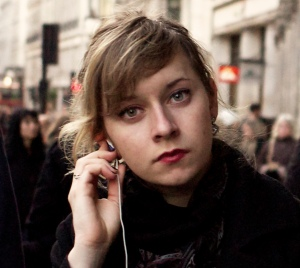 """Listening, Regent Street, London, 17 December 2011"" by Flickr user John Perivolaris, CC BY-NC-ND 2.0"