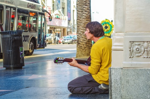 """Busker (street musician) #2"" by Flickr user Sunny Lapin, CC BY-NC-SA 2.0"