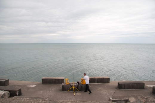 Jeff Kolar with Radius' mobile transmitter, the Audio Relay Unit, on the shore of Lake Michigan.