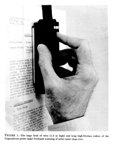A hand uses the metal probe of the Cognodictor to scan a typed document.