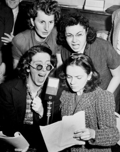 """Jane Hoffman, Tobey Weinberg, Ruth Goodman, and Amelia Romano read for a radio broadcast about the Triangle Fire"" by Flickr user Kheel Center, CC BY 2.0"