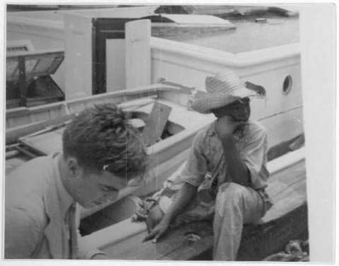 http://www.loc.gov/pictures/collection/lomax/item/2007660276/ Alan Lomax (left) and youngster on board boat, during Bahamas recording expedition