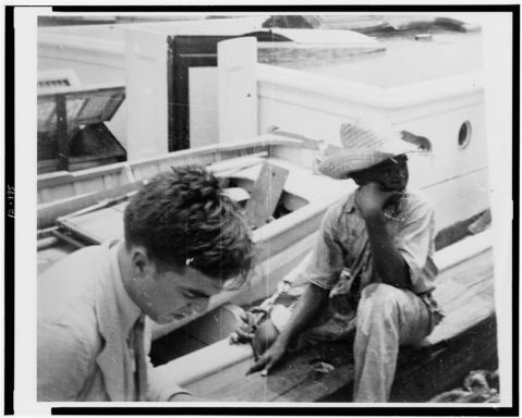 [Alan Lomax (left) youngster on board boat, during Bahamas recording expedition], 1935, Courtesy of the Library of Congress