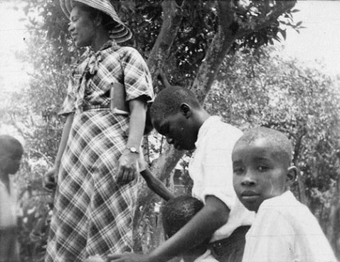 Zora Neale Hurston with three boys in Eatonville Florida, 1935. Hurston interviewed children and had them demonstrate their games as Alan Lomax documented the action. [Prints and Photographs, Call number: LOT 7414-C, no. N109a, frame 47].