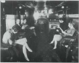 Passengers listening to radio broadcast aboard train, location unknown, 1929
