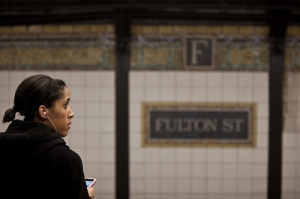 A woman waits at the Fulton Street subway stop in New York City on February 20, 2010.