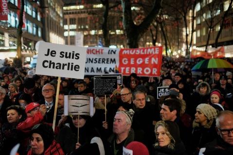 "Image of ""Je Suis Charlie"" solidarity demonstrations in Hamburg, Germany, by Flickr user Konrad Lembcke"