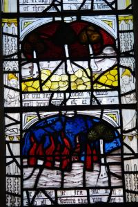 Stained glass depicting burning forests from a Richard Rolle poem at All Saints' Church on North Street in York. Image by dvdbramhall CC BY-NC-SA.